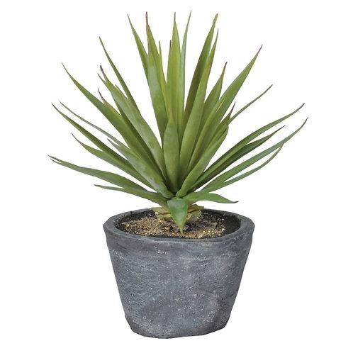 Faux plant in cement pot