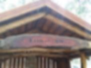 Close up of timber sign on hut
