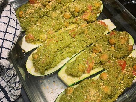 Arugula pesto, quinoa, chickpea stuffed zucchini boats