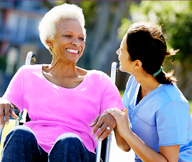 Nurse and older woman talking