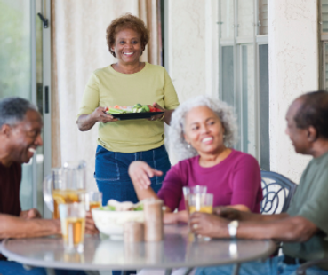 Older couples share a meal