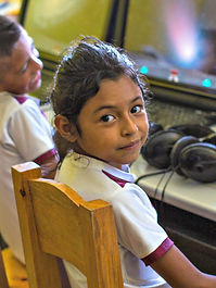 Student in computer lab at Helps International's primary school in Guatemala