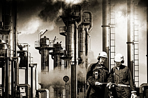 two-refinery-workers-with-industrial-pla