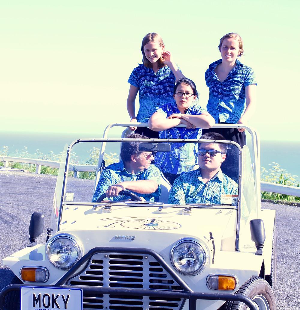 Dentists in Gisborne's Ocean Dental Centre driving Moky the Ocean Dental Mascot Car