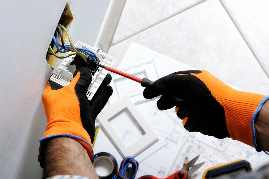 Electrician working safely on switches a