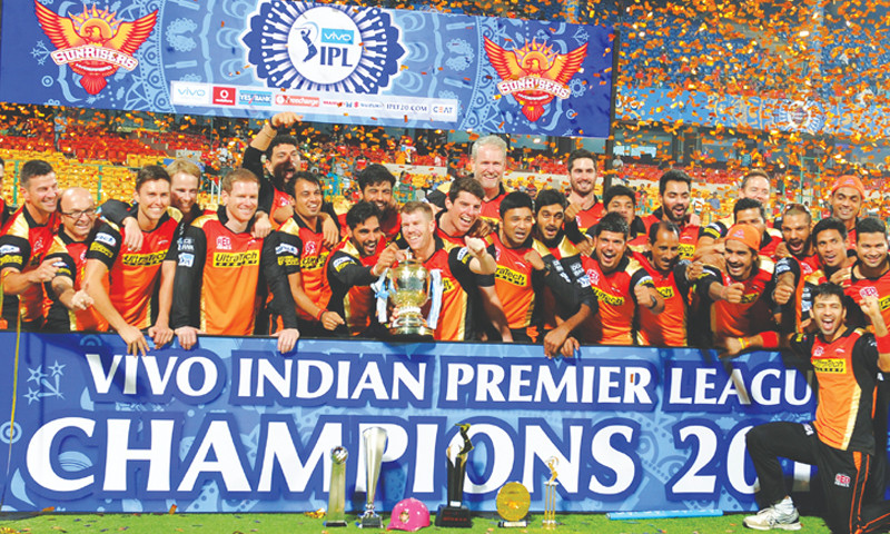 BANGALORE: Players and officials of Sunrisers Hyderabad pose with the trophy after winning the IPL final at the M. Chinnaswamy Stadium.