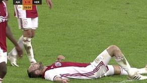 Footballer falls after his heart defibrillator goes off