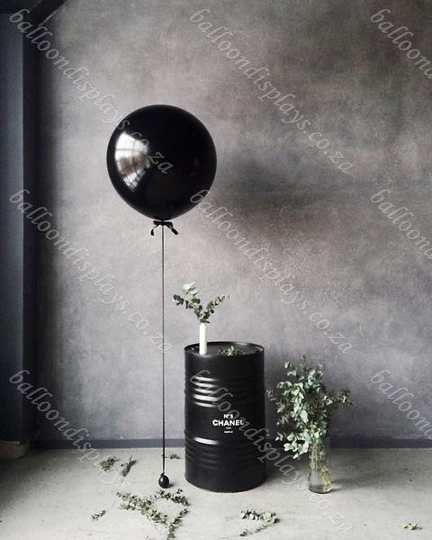 grayscale-photography-of-balloon-beside-
