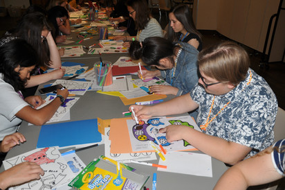 Students coloring activity books.