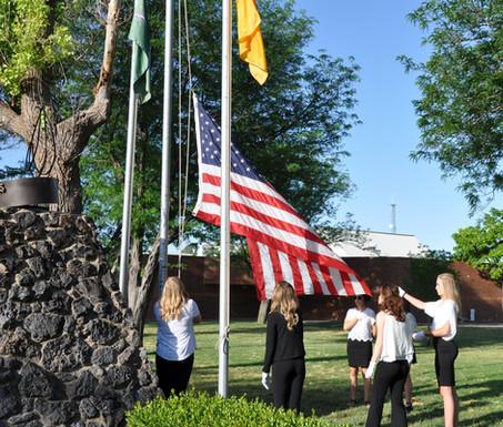 Delegates at a flag raising.
