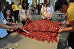 Delegates working on a lap blanket.