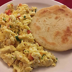 2 Scrambled Eggs served with a Corn Patty & Cheese / 2 Huevos Pericos con Arepa y Queso