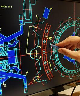engineer working on mechanichal piece computer design   .jpg