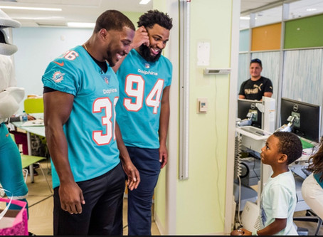 Dolphins Visit alex's place Pediatric Cancer Patients At Sylvester Comprehensive Cancer Center
