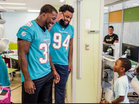 Dolphins Visit alex's place Pediatric Cancer Patients At Sylvester Comprehensive Cancer Center