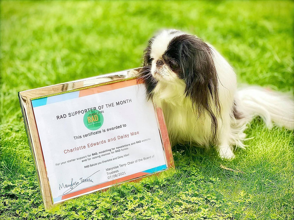 Daisy Mae with RAD supporter of the month award