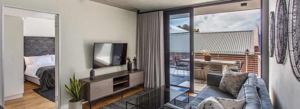 Lounge_1bedroom_Docklands_325_ITC_1.jpg