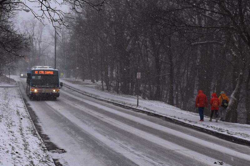 TCAT bus on a snowy Ithaca roadway.