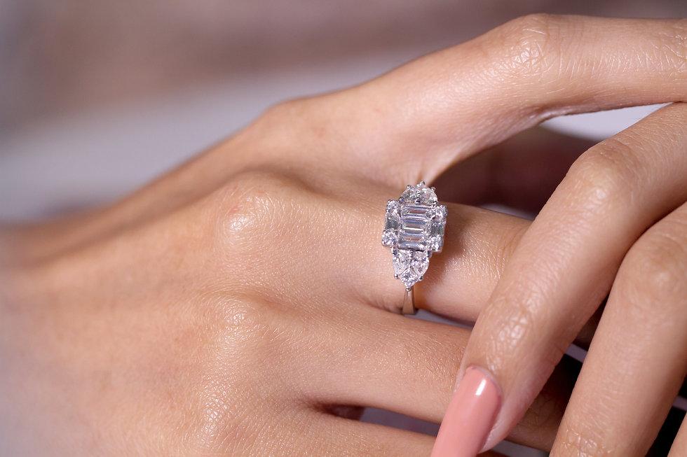 Diamond engagement ring on hand .jpg