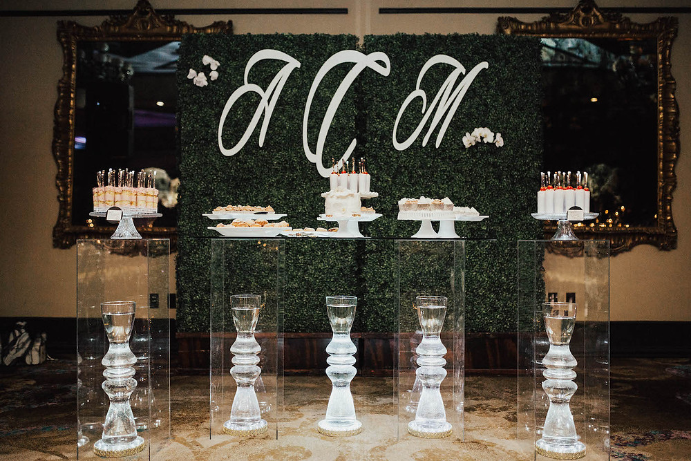 greenery wall clear columns dessert table grand bohemian custom monogram