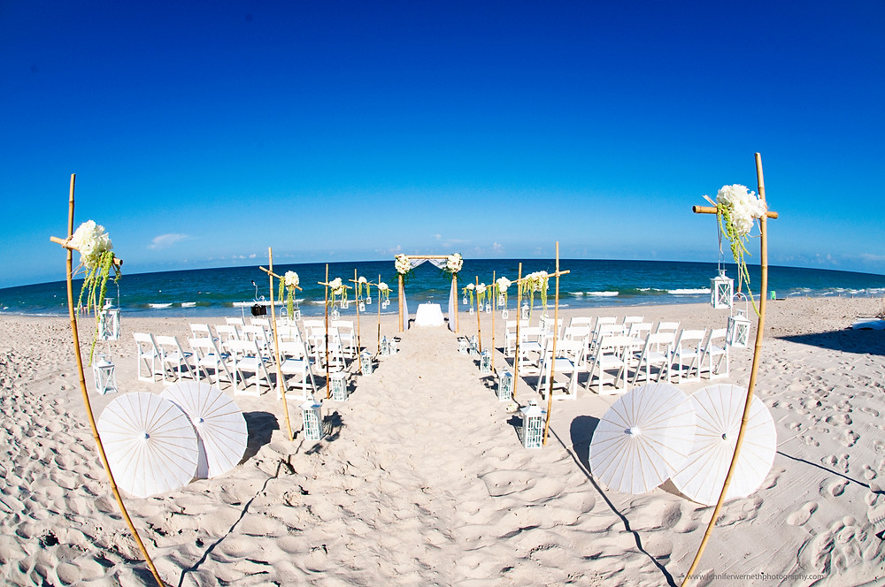 beach wedding vero costa d'este orlando wedding planner lanterns umbrella hydrangea amaranthus