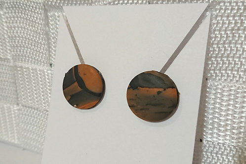 A pair of marbled black and orange earrings