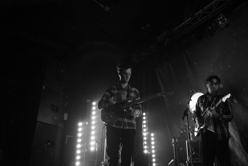 whitney band live in glasgow performing stage lights bulbs symmetry