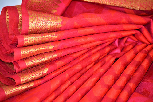 Brick red silk self weaved with  gold zari border and Anchal