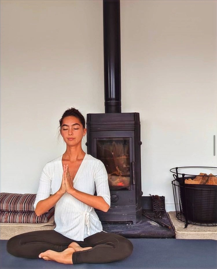 Yoga teacher sitting in a beginner's yoga pose