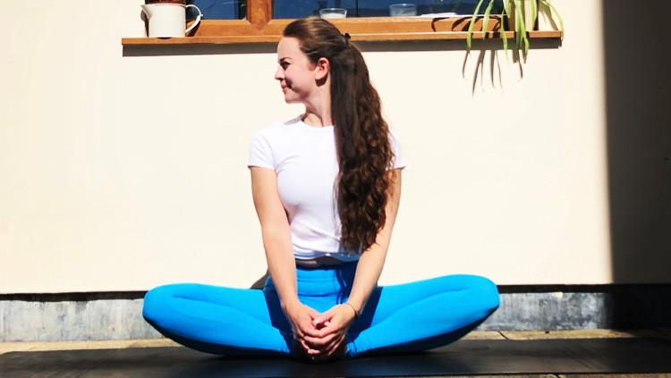 Yoga teacher sitting in a yoga pose in Bristol
