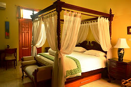 Guest Room 1 at this Jakarta BedandBreakfast has a lovely canopy bed.