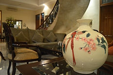 This beautiful BedandBreakfast in Jakarta has charming seating areas.
