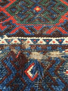 Moth damage on a Kurdish rug being repair