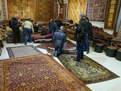 Looking at rugs in Isfahan, Iran