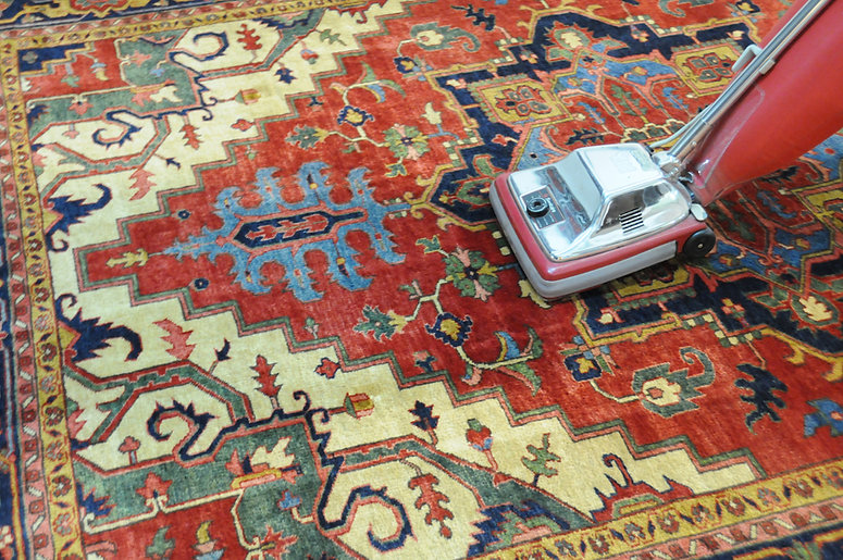 Rug being vacuumed