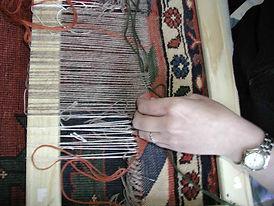 reweaving damaged rug
