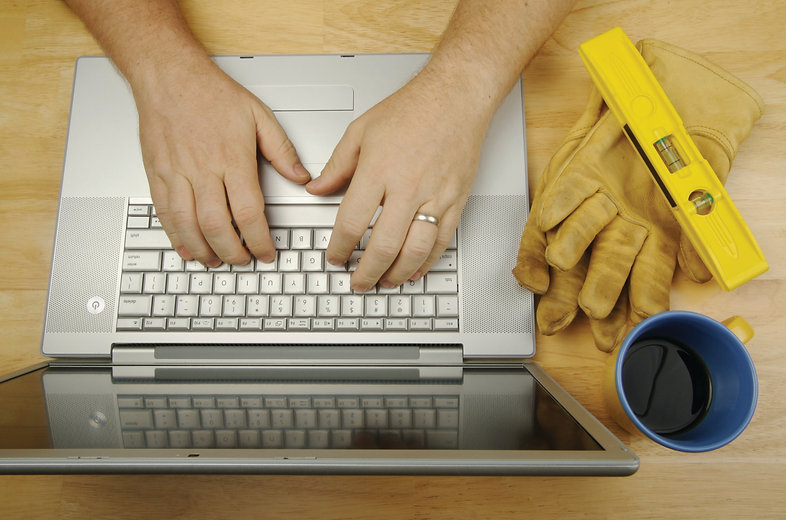iStock_000004062279_Large Contractor Reviews Project Laptop.jpg