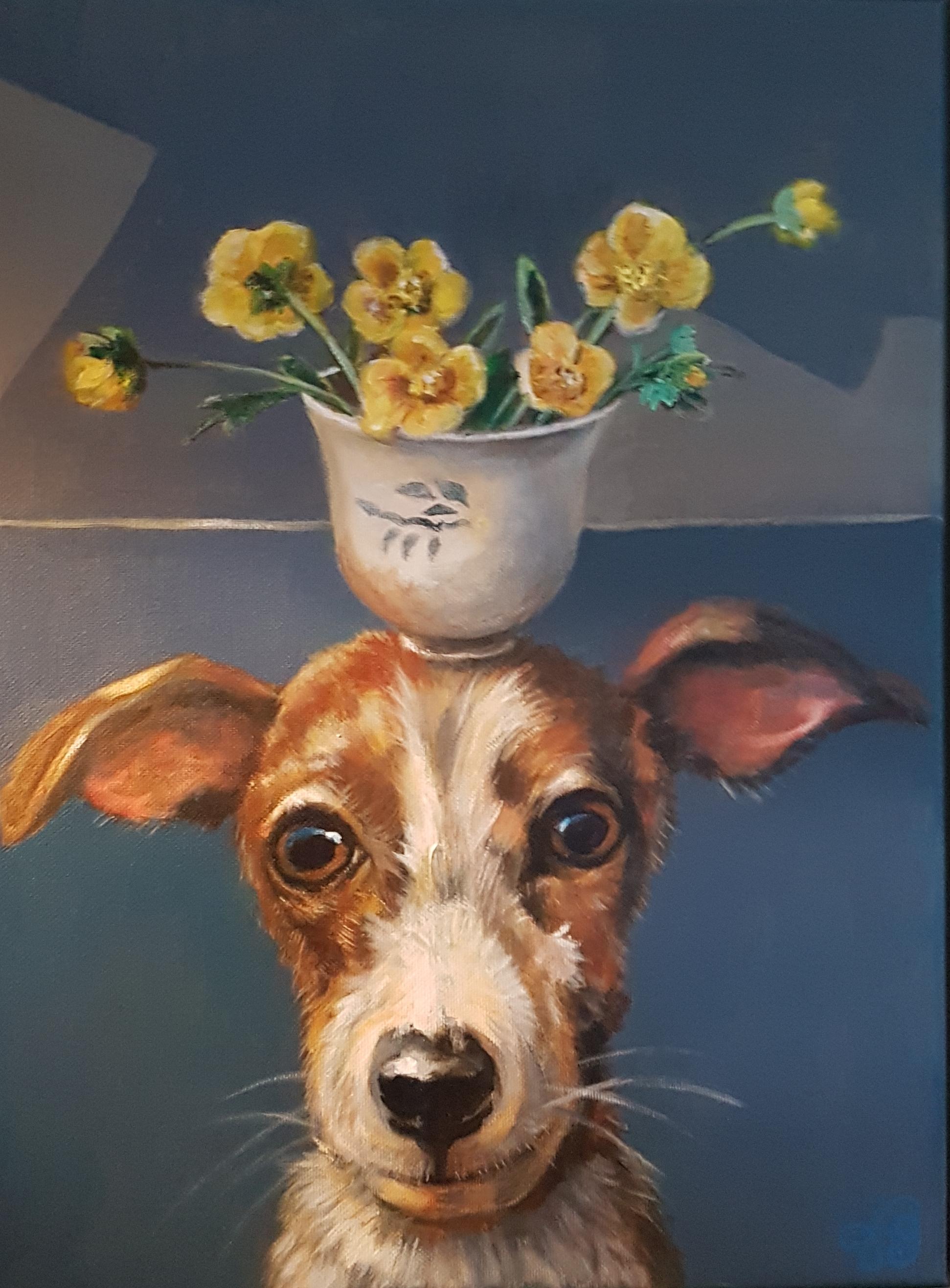 Hond met kopje boterbloemen