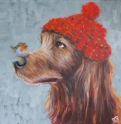Hond met roodborsje