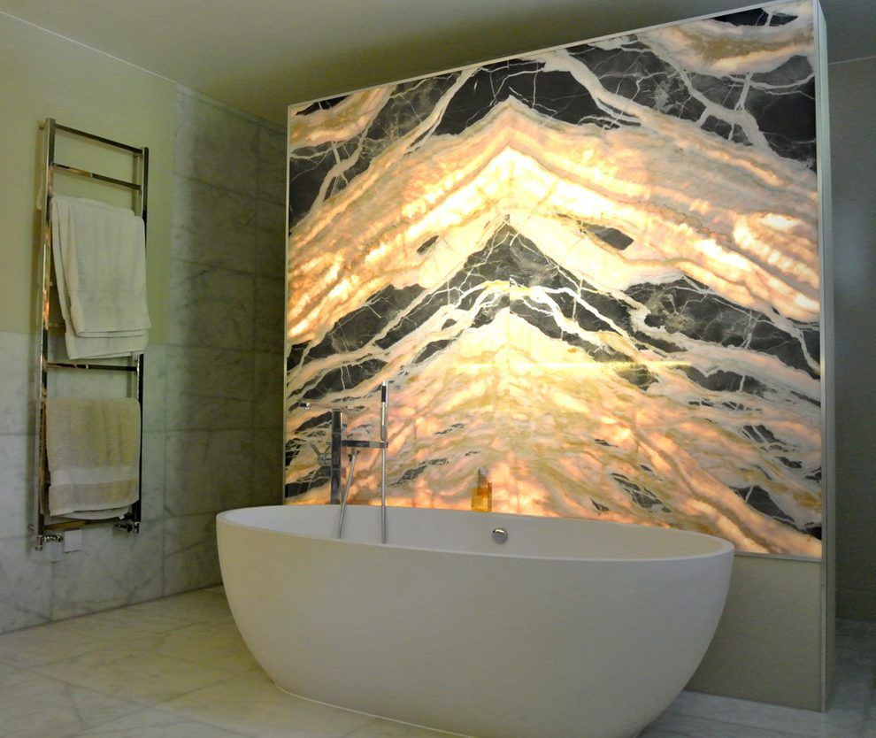 london backlit onyx wall with bedding an
