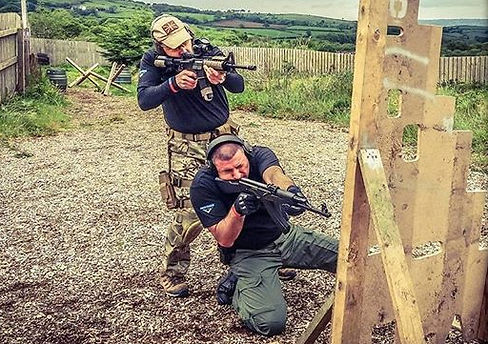 Our FT4FT Instructors Shooting an AR15 and AK47 around a barricade