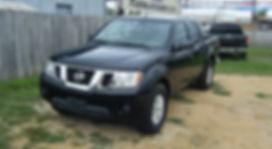 2014 Nissan Frontier crew black 001.JPG