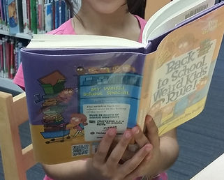 Child reading a book at the Tenafly Public Library