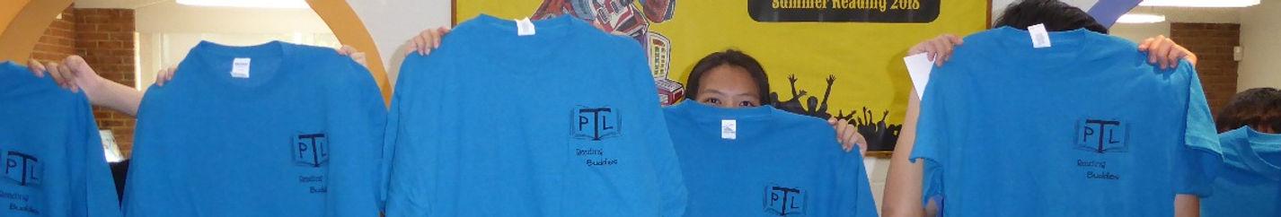 Teen Reading Buddy Volunteers displaying Teen Volunteer t-shirts