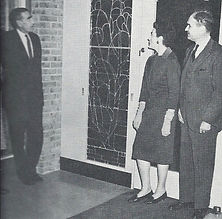 Stained glass panel at the entrance of the Tenafly Public Library circa 1963. Also pictured Karl Lamb, donor of stained glass panels, Mrs. K. L. Tait, designer of stained glass panels and R. Worth Vaughn, President of the Library Board of Trustees.