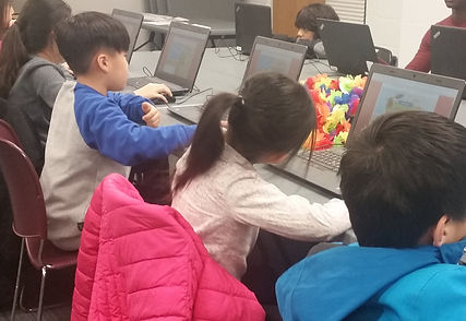 Children wth laptops at a coding class at the Tenafly Public Library