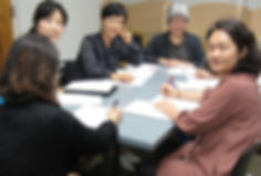 Students and teacher in Adult ESL group class