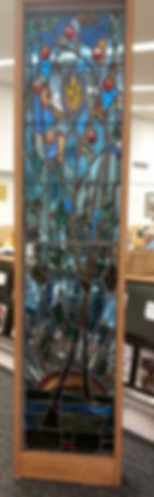 Tree of Knowledge stained glass panel at the entrance of the Edna Kaulitzki art gallery in the Tenafly Public Library.