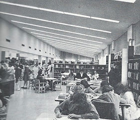 Image of the interior of the Tenafly Public Library from the south of the building looking north toward the children's room circa 1963