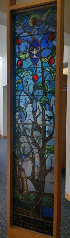 Tree of life stained glass panel currently at the entrance of the Edna Kawulitzki art gallery in the Tenafly Public Library